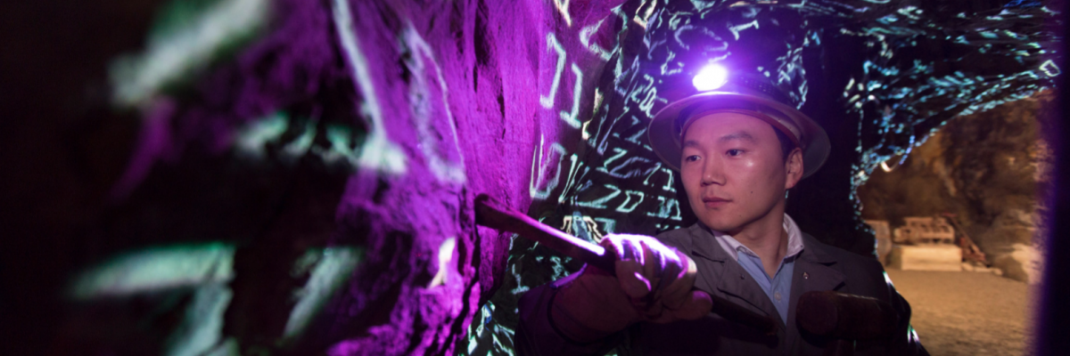 Environmental portraits of Jaewoo Lee 'data mining' in a gold mine.